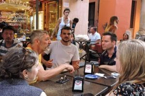 students socializing learning italian doing aperitivo with italians in the center of bologna