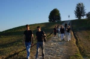 students learn italian in italy walking on the hills of Bologna