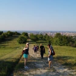 students of cultura italiana bologna walking in the hills